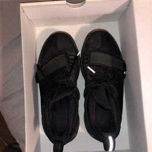 Kids Nike black tennis shoes
